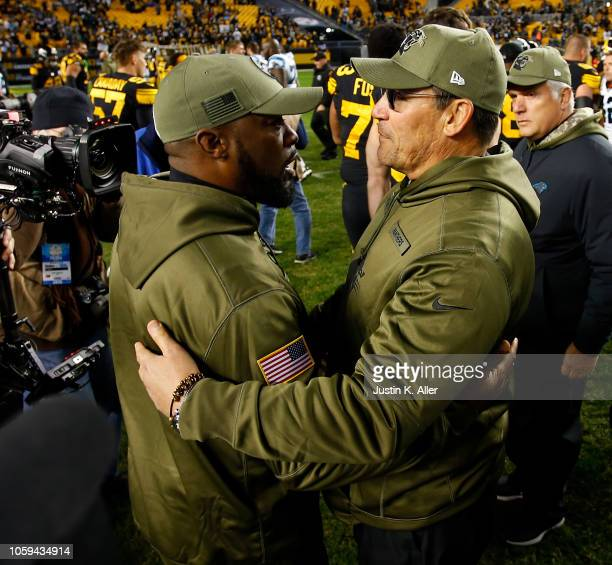 Head coach Mike Tomlin of the Pittsburgh Steelers shakes hands with head coach Ron Rivera of the Carolina Panthers at the conclusion of the 5221 win...