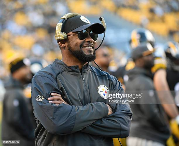 Head coach Mike Tomlin of the Pittsburgh Steelers smiles as he looks on from the sideline during a game against the Cleveland Browns at Heinz Field...