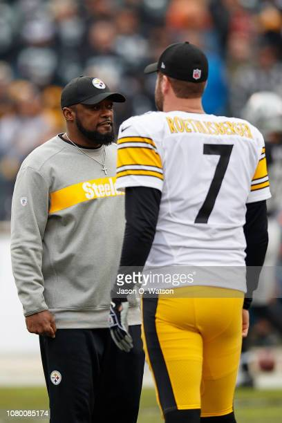 Head coach Mike Tomlin of the Pittsburgh Steelers talks to quarterback Ben Roethlisberger before the game against the Oakland Raiders at the Oakland...