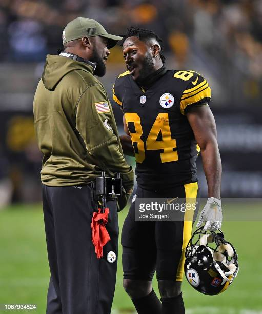 Head coach Mike Tomlin of the Pittsburgh Steelers talks with Antonio Brown during the game against the Carolina Panthers at Heinz Field on November 8...