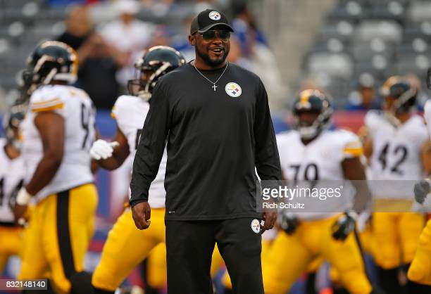 Head coach Mike Tomlin of the Pittsburgh Steelers talks with officials before an NFL preseason game against the New York Giants at MetLife Stadium on...