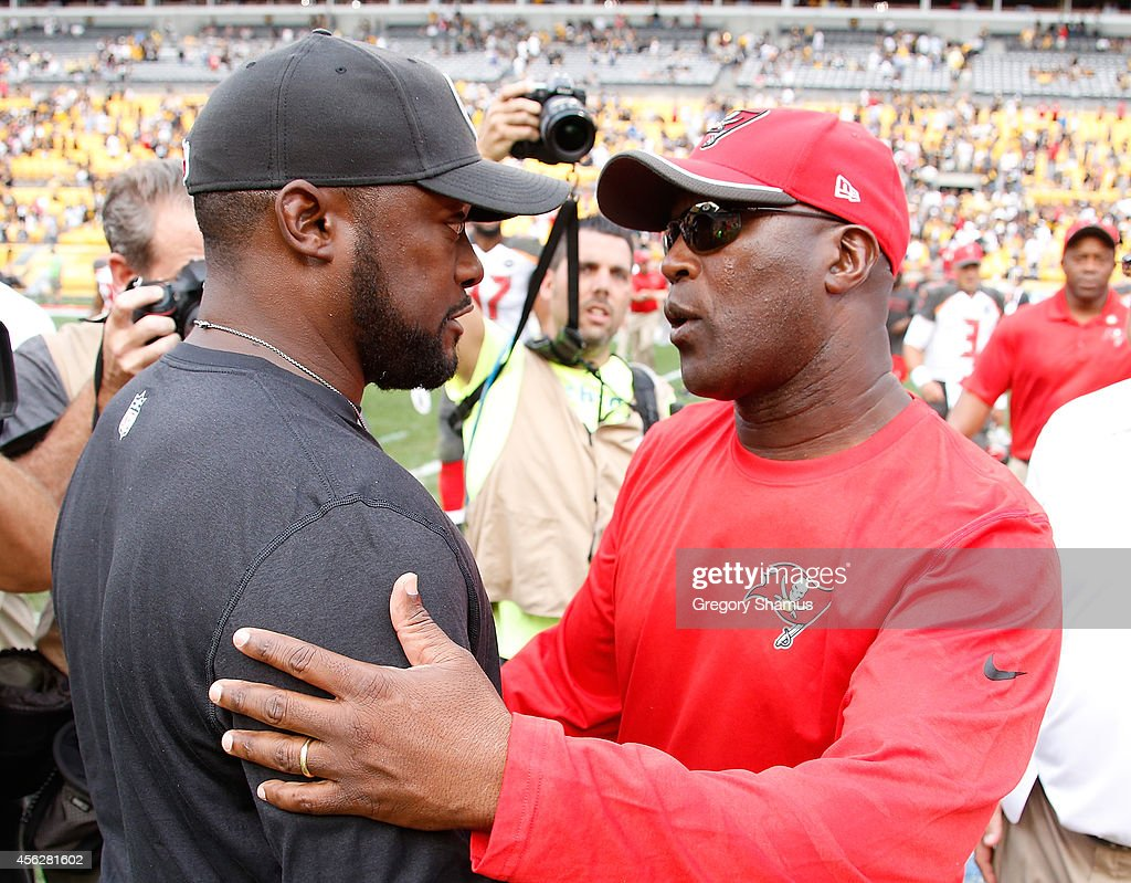 Head coach Mike Tomlin of the Pittsburgh Steelers talks with head coach Lovie Smith of the Tampa Bay Buccaneers after Tampa Bay's 27-24 win at Heinz Field on September 28, 2014 in Pittsburgh, Pennsylvania.