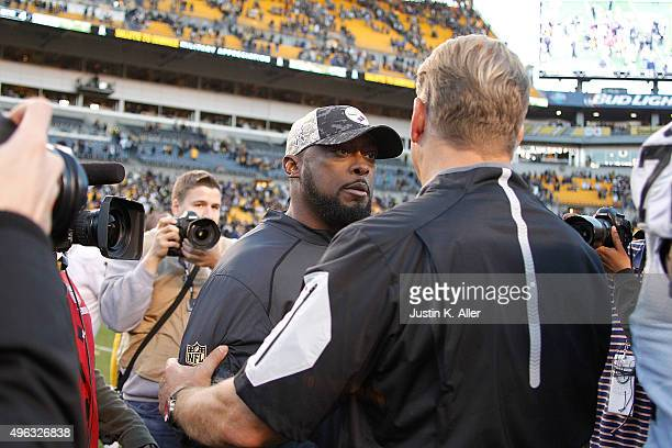Head Coach Mike Tomlin of the Pittsburgh Steelers talks with Head Coach Jack Del Rio of the Oakland Raiders after the game at Heinz Field on November...