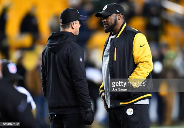 Head coach Mike Tomlin of the Pittsburgh Steelers talks with head coach John Harbaugh of the Baltimore Ravens before the game at Heinz Field on...