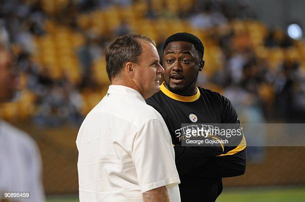 Head coach Mike Tomlin of the Pittsburgh Steelers talks with Kevin Colbert Steelers director of football operations before a game against the...