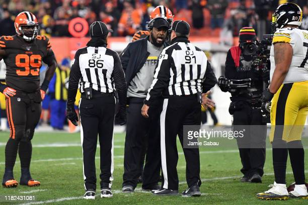 Head Coach Mike Tomlin of the Pittsburgh Steelers talks with officials on the field after a fight broke out between Steelers players and the...
