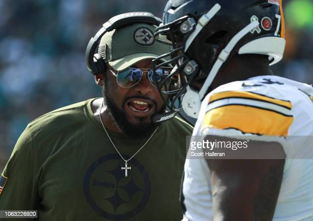 Head coach Mike Tomlin of the Pittsburgh Steelers talks with one of his players during the first half against the Jacksonville Jaguars at TIAA Bank...
