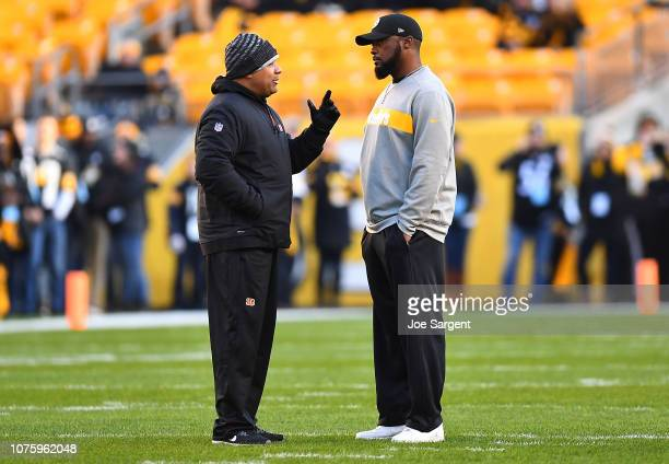 Head coach Mike Tomlin of the Pittsburgh Steelers talks with special assistant to the head coach Hue Jackson of the Cleveland Browns during warmups...
