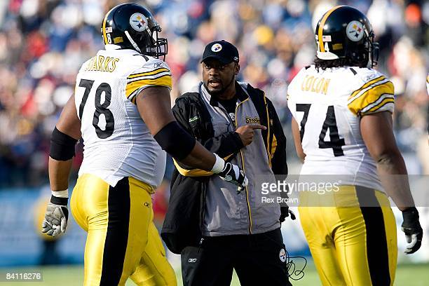 Head coach Mike Tomlin of the Pittsburgh Steelers talks with offensive tackle Max Starks after a touchdown against the Tennessee Titans on December...