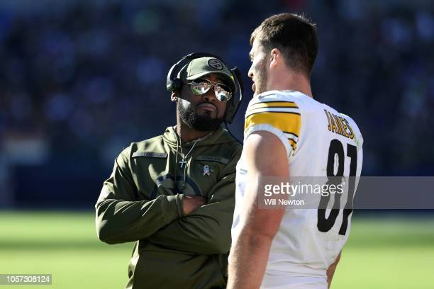 Head Coach Mike Tomlin of the Pittsburgh Steelers talks with tight end Jesse James on the sidelines during the second quarter against the Baltimore...
