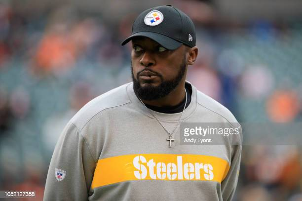 Head coach Mike Tomlin of the Pittsburgh Steelers walks on the field during warmups prior to the start of the game against the Cincinnati Bengals at...