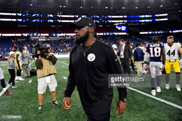 Head coach Mike Tomlin of the Pittsburgh Steelers walks on the field after being defeated 333 by the New England Patriots at Gillette Stadium on...