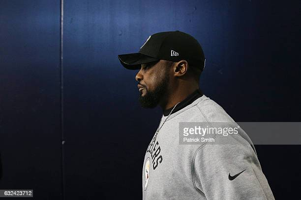 Head coach Mike Tomlin of the Pittsburgh Steelers walks to the field prior to the AFC Championship Game against the New England Patriots at Gillette...