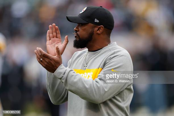 Head coach Mike Tomlin of the Pittsburgh Steelers watches his team during warm ups before the game against the Oakland Raiders at the Oakland...