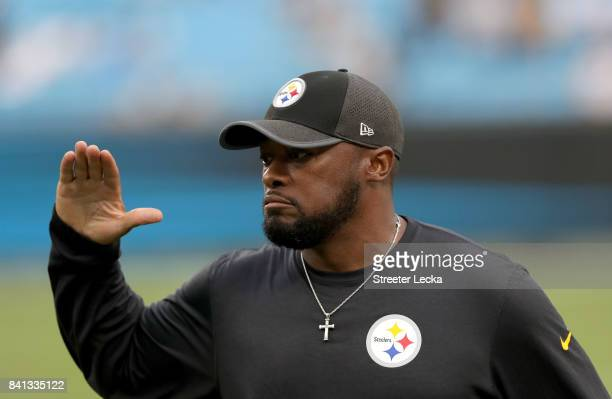 Head coach Mike Tomlin of the Pittsburgh Steelers watches on ahead of their game against the Carolina Panthers at Bank of America Stadium on August...