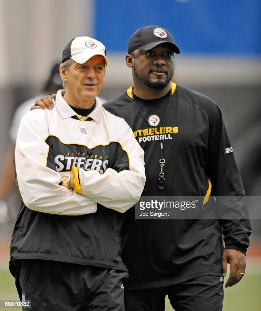 Head coach Mike Tomlin of the Pittsburgh Steelers watches practice alongside defensive coordinator Dick LeBeau during rookie training camp at the...