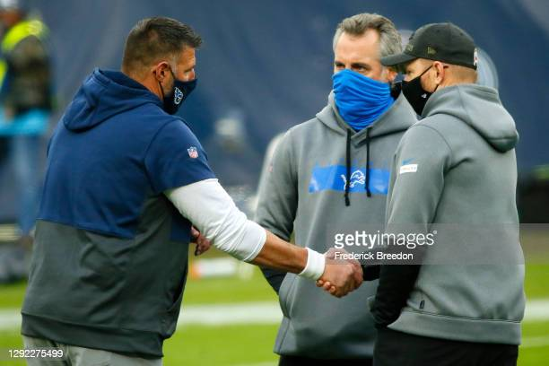 Head coach Mike Vrabel of the Tennessee Titans and head coach Darrell Bevell of the Detroit Lions shake hands during warm ups prior to the game at...