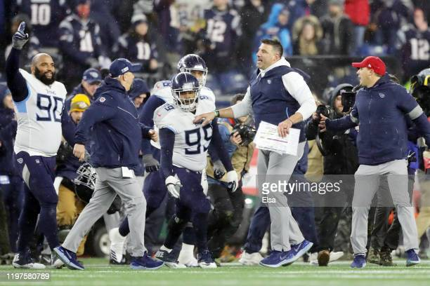 Head coach Mike Vrabel of the Tennessee Titans and Jurrell Casey celebrate their 2013 win over the New England Patriots in the AFC Wild Card Playoff...