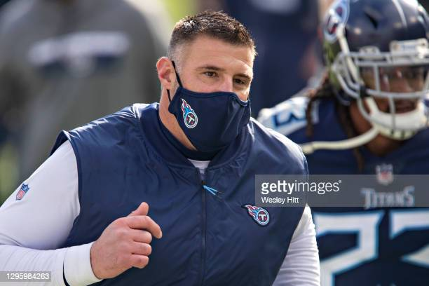 Head Coach Mike Vrabel of the Tennessee Titans jogs to the locker room before their AFC Wild Card Playoff game against the Baltimore Ravens at Nissan...