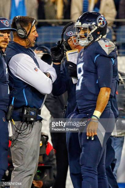 Head coach Mike Vrabel of the Tennessee Titans speaks to quarterback Marcus Mariota during a game against the Jacksonville Jaguars at Nissan Stadium...