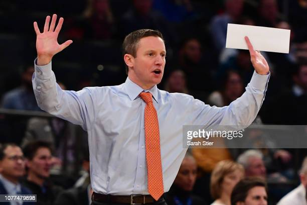 Head coach Mike White of the Florida Gators directs his players during the first half of the game against the West Virginia Mountaineers at Madison...