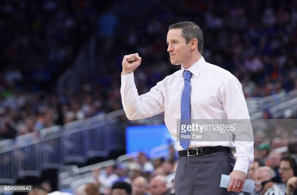 Head coach Mike White of the Florida Gators reacts in the first half against the Virginia Cavaliers during the second round of the 2017 NCAA Men's...