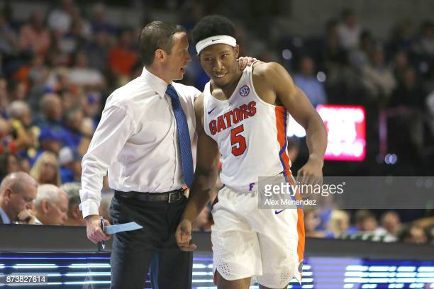 Head coach Mike White of the Florida Gators speaks with KeVaughn Allen during an NCAA basketball game against the GardnerWebb Runnin Bulldogs at the...