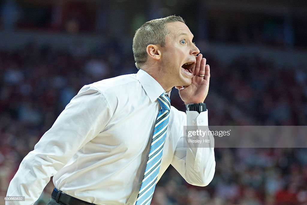 Head Coach Mike White of the Florida Gators yells to his team during a game against the Arkansas Razorbacks at Bud Walton Arena on December 29, 2016 in Fayetteville, Arkansas. The Gators defeated the Razorbacks 81-72.