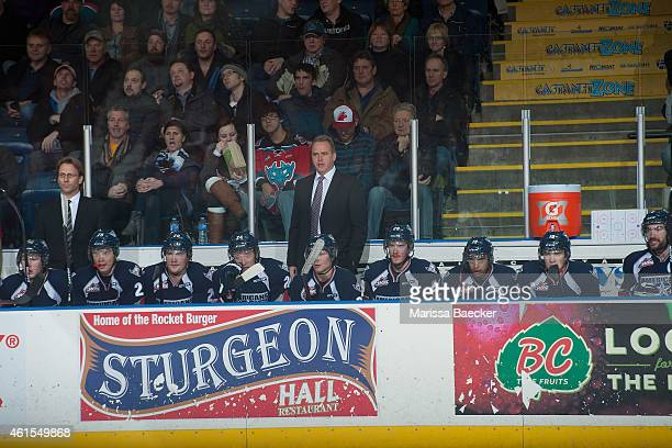 Head coach Mike Williamson of Tri City Americans stands on the bench against the Kelowna Rockets on January 14 2015 at Prospera Place in Kelowna...