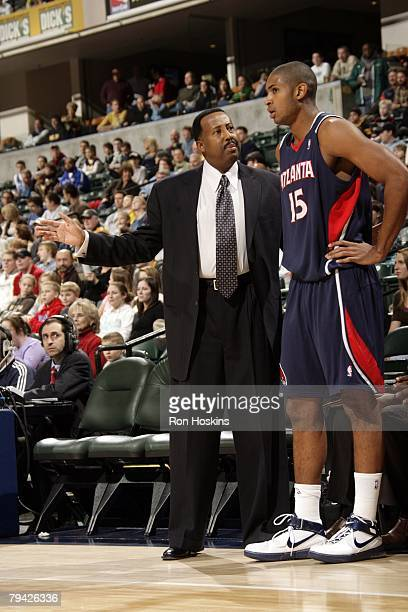 Head Coach Mike Woodson of the Atlanta Hawks has a word with Al Horford of the Atlanta Hawks on the sideline during their game against the Indiana...