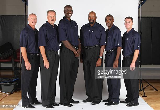 Head coach Mike Woodson of the Atlanta Hawks poses for a portrait with his assistant coaches Bob Bender Jim Todd Tyrone Hill Larry Drew and Mark...