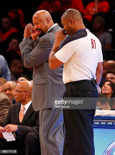 Head coach Mike Woodson of the New York Knicks gets animated in a discussion with an official in the second half against the Toronto Raptors during...