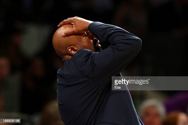 Head Coach Mike Woodson of the New York Knicks reacts after a bad play against the Indiana Pacers during Game Five of the Eastern Conference...
