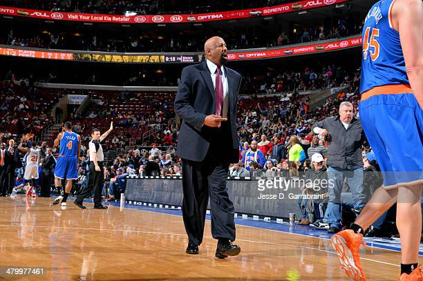Head Coach Mike Woodson of the New York Knicks walks on the court during a game against the Philadelphia 76ers at the Wells Fargo Center on March 21...