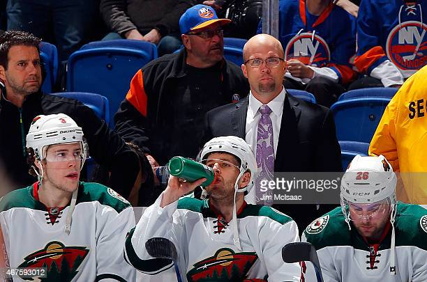 Head coach Mike Yeo of the Minnesota Wild looks on against the New York Islanders on March 24 2015 at Nassau Veterans Memorial Coliseum in Uniondale...