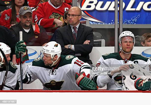 Head coach Mike Yeo of the Minnesota Wild watches as his team takes on the Chicago Blackhawks in Game Two of the Second Round of the 2014 NHL Stanley...