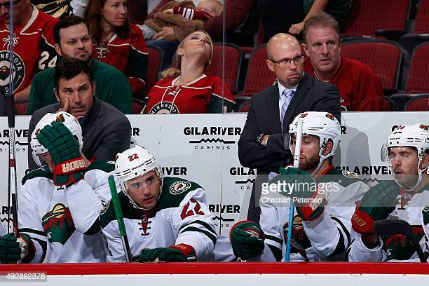 Head coach Mike Yeo of the Minnesota Wild watches from the bench during the first period of the NHL game against the Arizona Coyotes at Gila River...