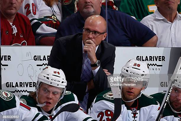 Head coach Mike Yeo of the Minnesota Wild watches from the bench during the NHL game against the Arizona Coyotes at Gila River Arena on October 15...