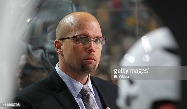 Head Coach Mike Yeo of the Minnesota Wild watches the action in their game against the Buffalo Sabres from behind the bench on January 15 2015 at the...