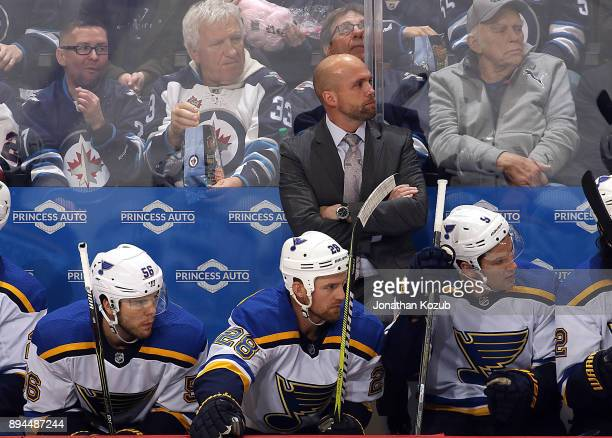 Head Coach Mike Yeo of the St Louis Blues looks on from the bench during third period action against the Winnipeg Jets at the Bell MTS Place on...