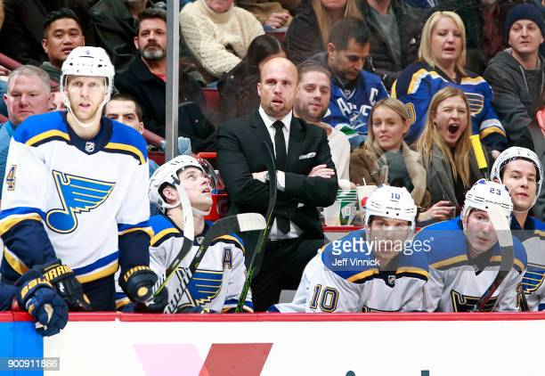 Head coach Mike Yeo of the St Louis Blues looks on from the bench during their NHL game against the Vancouver Canucks at Rogers Arena December 23...