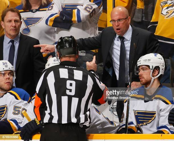 Head coach Mike Yeo of the St Louis Blues talks to a referee after a penalty was called favoring the Nashville Predators during the third period of...