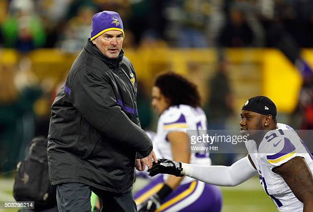Head coach Mike Zimmer of the Minnesota Vikings greets Edmond Robinson of the Minnesota Vikings prior to their game against the Green Bay Packers at...