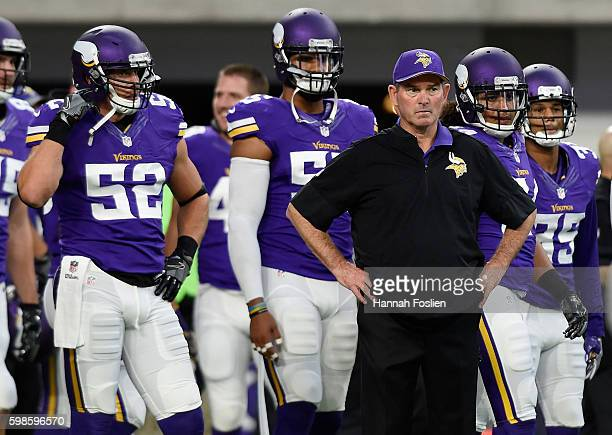 Head coach Mike Zimmer of the Minnesota Vikings looks on as his team warms up before the game against the Los Angeles Rams on September 1 2016 at US...