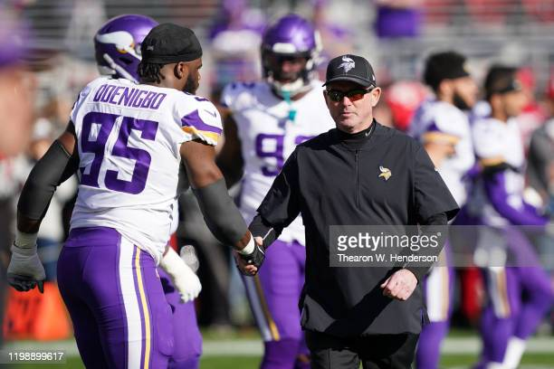 Head coach Mike Zimmer of the Minnesota Vikings shakes hands with Ifeadi Odenigbo during warm ups prior to their game against the San Francisco 49ers...