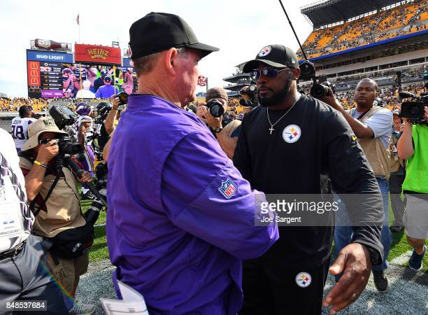 head coach Mike Zimmer of the Minnesota Vikings shakes hands with head coach Mike Tomlin of the Pittsburgh Steelers at the conclusion of the...