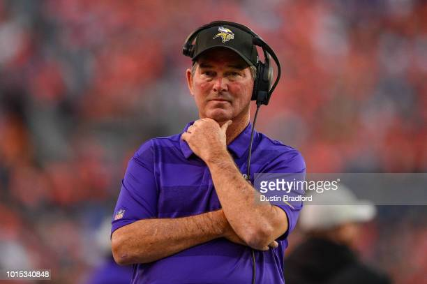 Head coach Mike Zimmer of the Minnesota Vikings stands on the sideline during an NFL preseason game against the Denver Broncos at Broncos Stadium at...