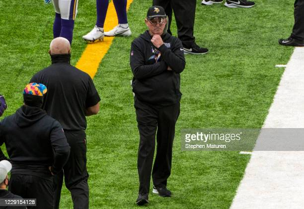 Head coach Mike Zimmer of the Minnesota Vikings walks along the sideline in the second quarter of the game against the Atlanta Falcons at US Bank...