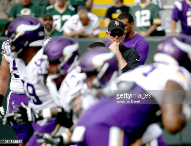Head coach Mike Zimmer of the Minnesota Vikings watches his team warm up before a game against the Green Bay Packers at Lambeau Field on September 16...