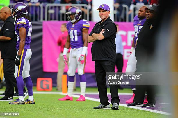 Head coach Mike Zimmer of the Minnesota Vikings watches warm ups at the game against the Houston Texans on October 9 2016 at US Bank Stadium in...